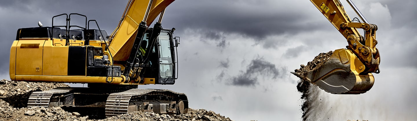 Excavator at contruction site in need of waste removal