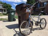 Bike Leaning Against Trash Cart