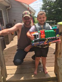 Rumpke Driver Joe King delivers toy trash truck to his biggest fan