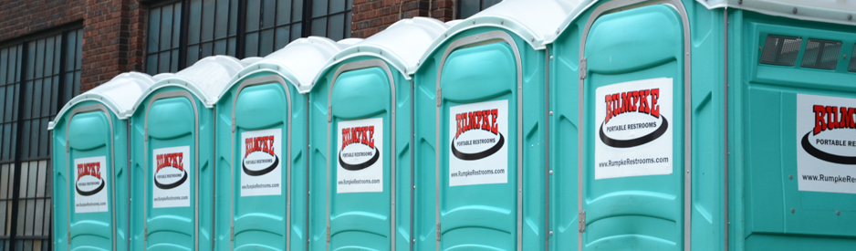 Row of portable restrooms outside an event