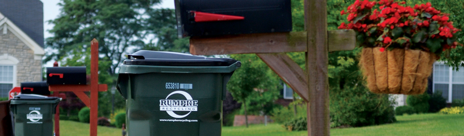 Recycling bins outside of homes in a neighborhood